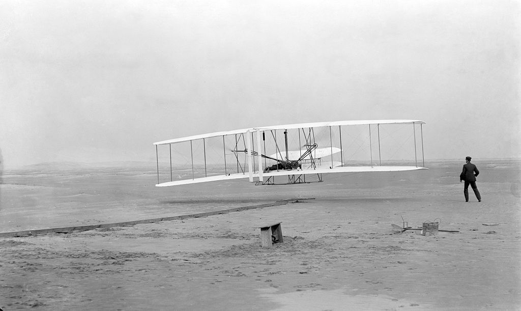 First successful flight of the Wright Flyer. The machine traveled 120 ft. in 12 seconds at 10:35 AM at Kitty Hawk, North Carolina, 1903.